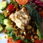 Salad with Curried Black Eyed Peas: tomatoes, cucumbers, feta, walnuts, hummus & balsamic-honey vinaigrette