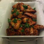 Curried glatt chicken wings coated in a sweet and spicy coconut-curry glaze