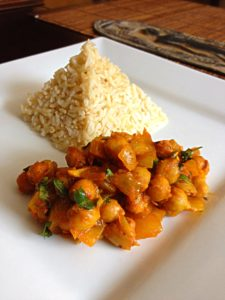 Steamed brown basmati rice with chick peas curry
