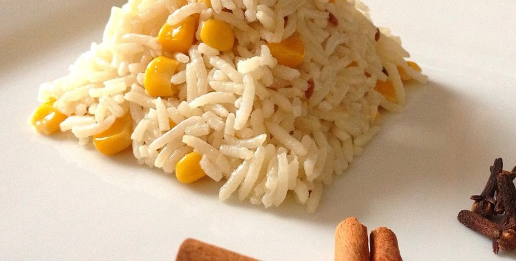 Coconut corn pulau: basmati rice with whole spices, coconut milk, and sweet corn