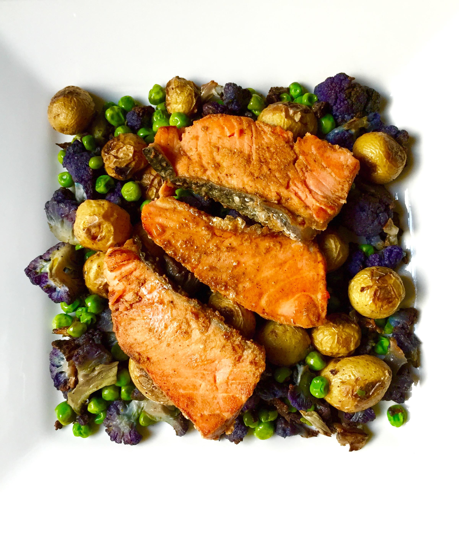Salmon Tikka over oven-roasted potatoes, cauliflower, and green peas
