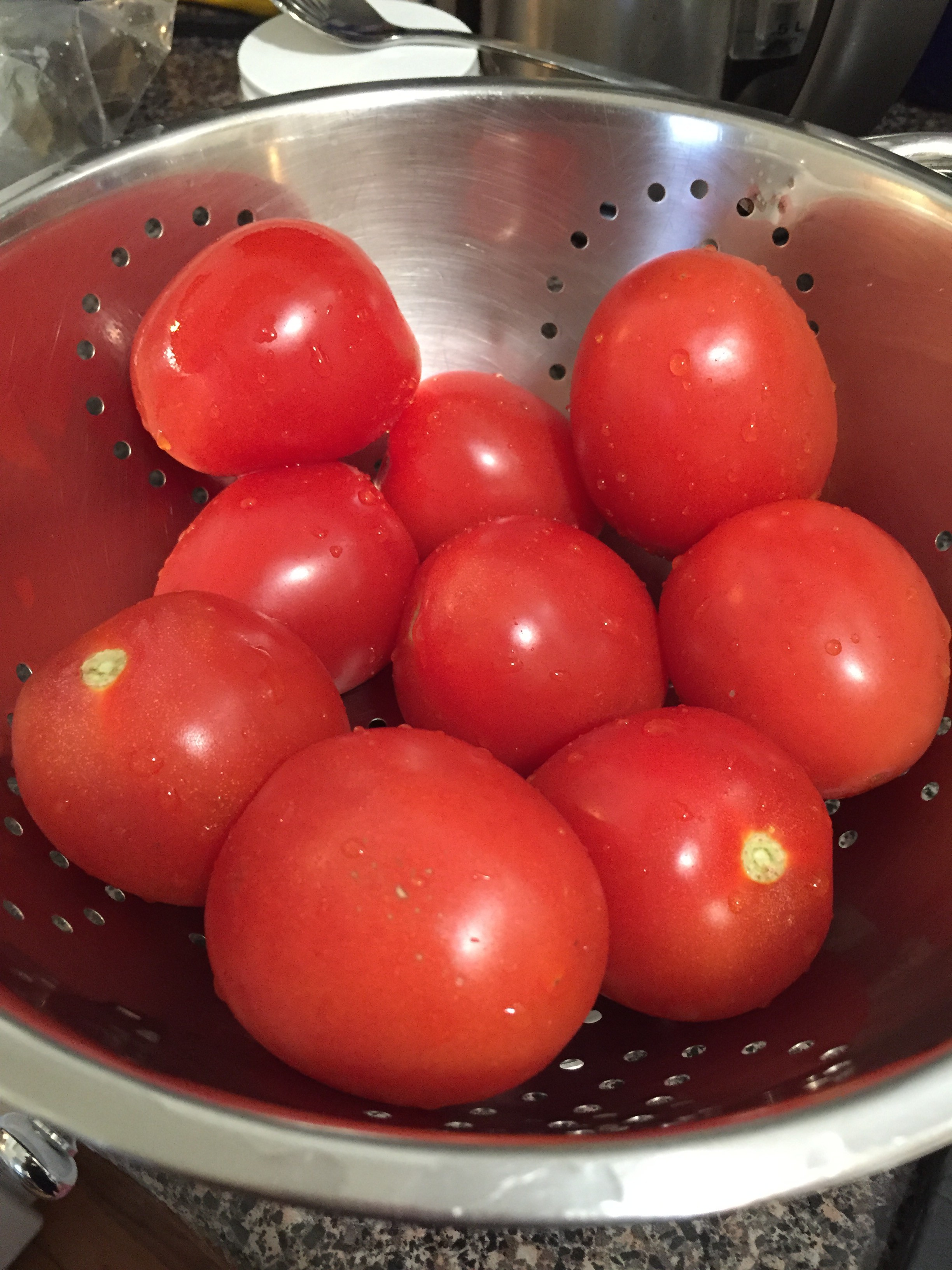 Signs of summer: fresh, red tomatoes